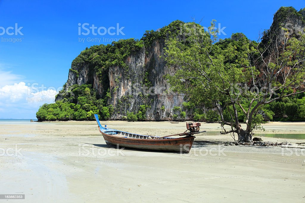 Beached long tail boat royalty-free stock photo
