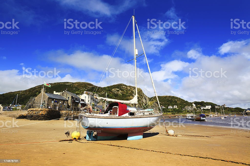 Beached sailboat at Barmouth, Wales stock photo