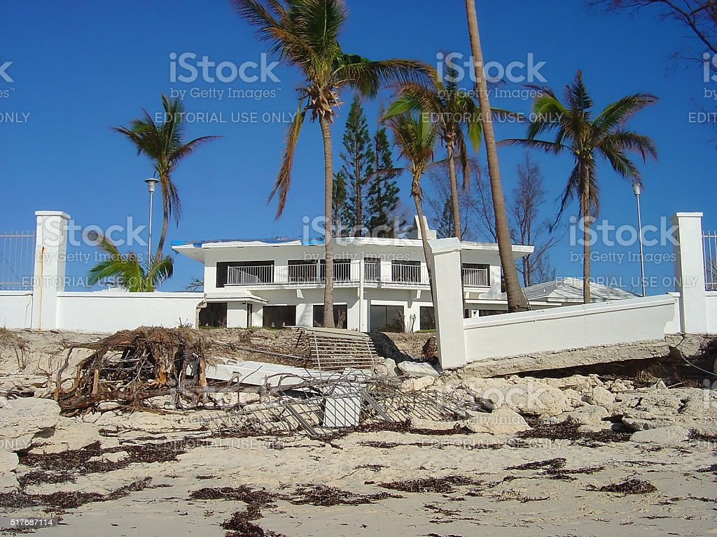 Beachfront property in Bahamas damaged by hurricane winds and waves stock photo