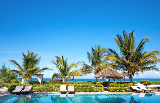 Swimming pool in luxury resort near Indian ocean (Zanzibar island, Tanzania). Property released.