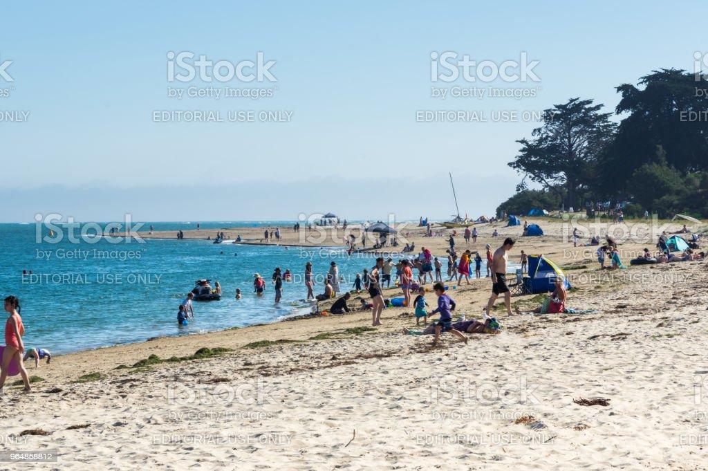 Beachgoers on Inverloch beach in South Gippsland in Australia. royalty-free stock photo