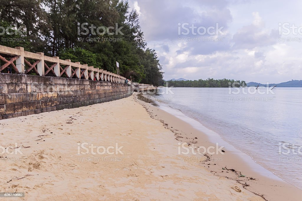 Beachside concrete retaining wall when low tide, Thailand stock photo