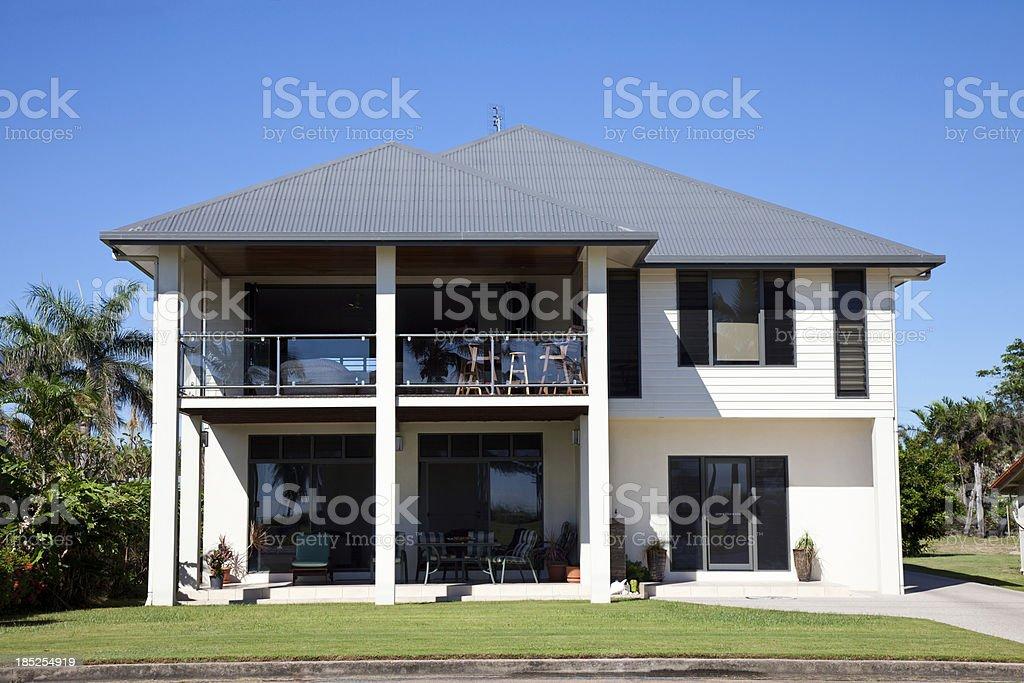 Beachside Home with blue sky stock photo