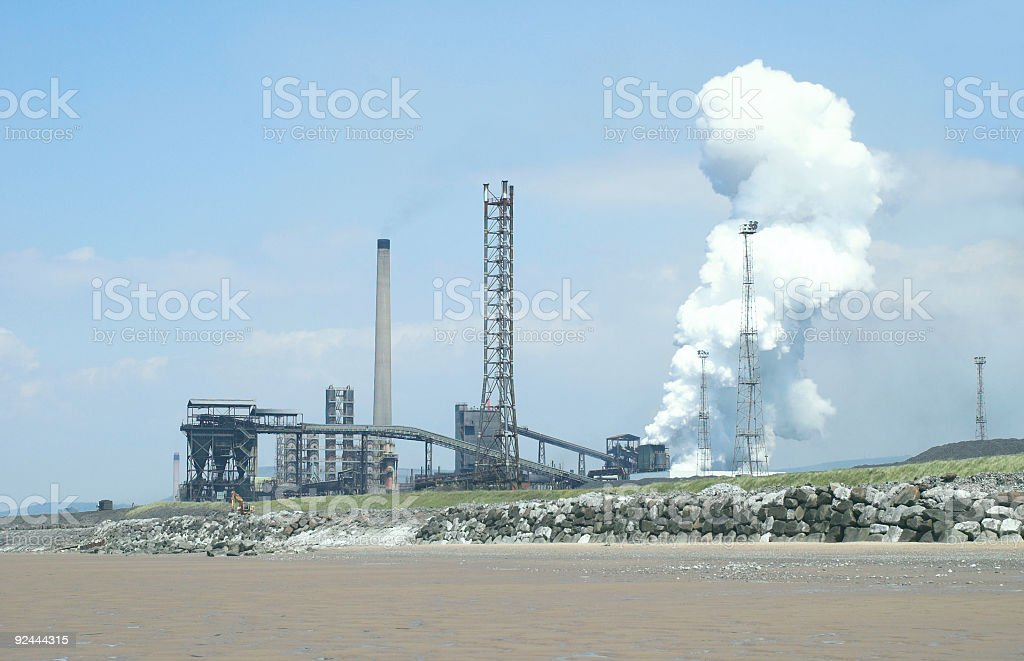 beachside steel plant royalty-free stock photo