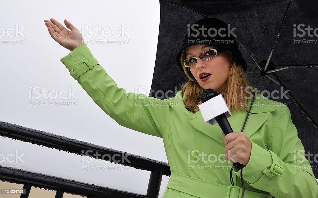 Beachside Weathergirl Reporting on Precipitation royalty-free stock photo
