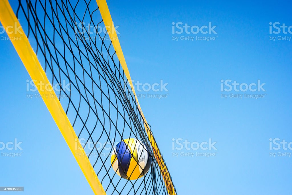 Beachvolley ball caught in net stock photo