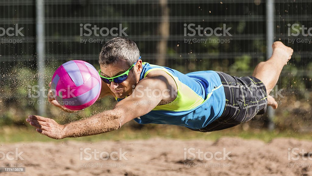 Beachvolleyballer flying stock photo