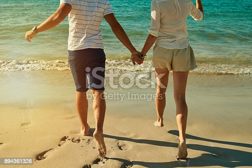 174919648 istock photo Beachy days are barefoot days 894361326