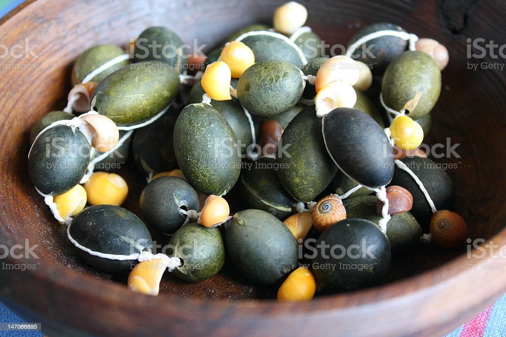 bead necklace from shells and algae in a woodbowl royalty-free stock photo