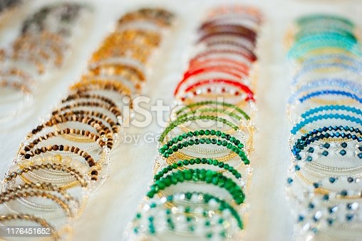 Rows of beaded bracelets at a craft show