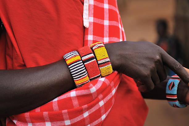 Beaded bracelets of Masai warrior close-up stock photo