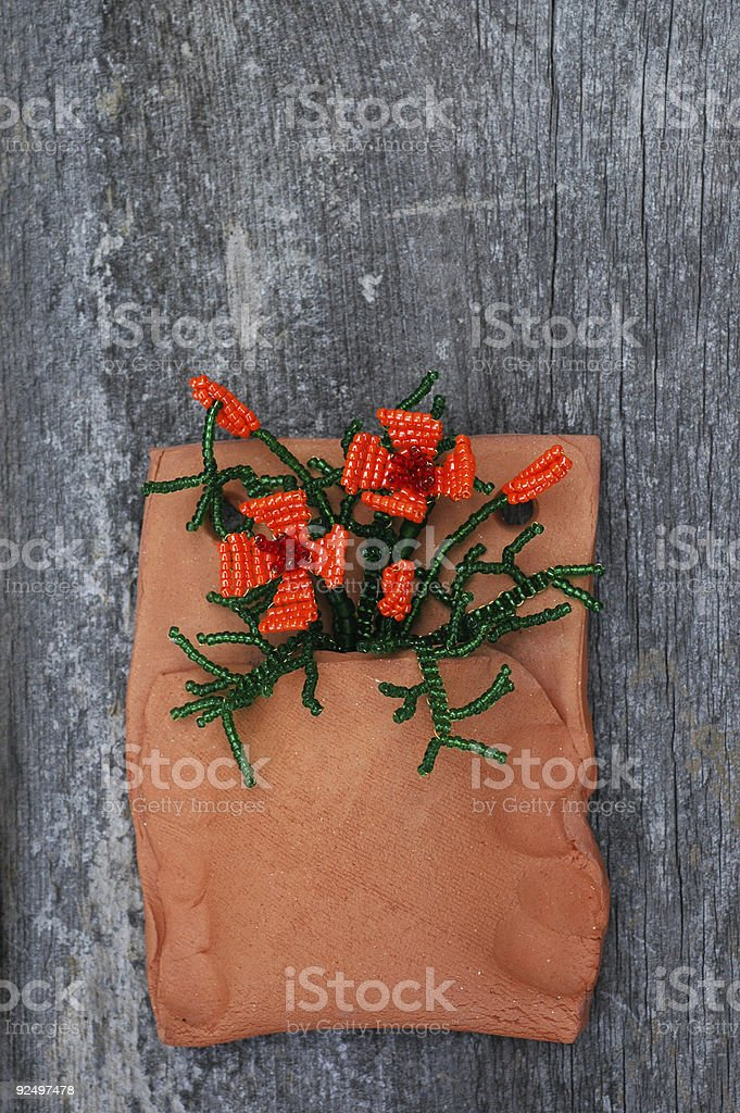 beaded California poppies in weed pot royalty-free stock photo