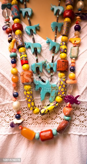 Beaded Coral and Turquoise Necklaces on Neck