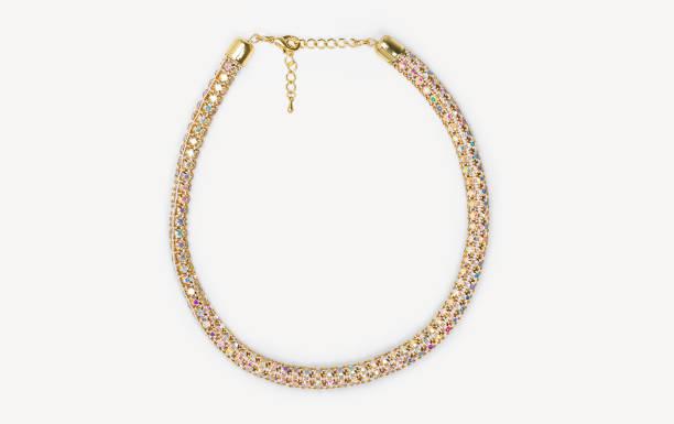 beaded gold metal and colorful precious stones necklace isolated on white background - ожерелье стоковые фото и изображения