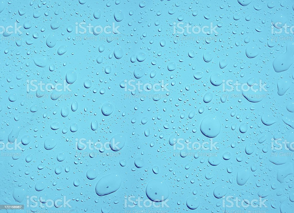 Beaded Water Drops on a Teal Surface royalty-free stock photo