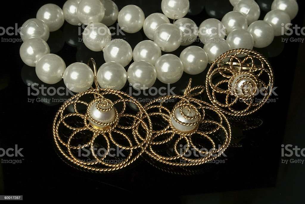 Beads and gold jewelry royalty-free stock photo