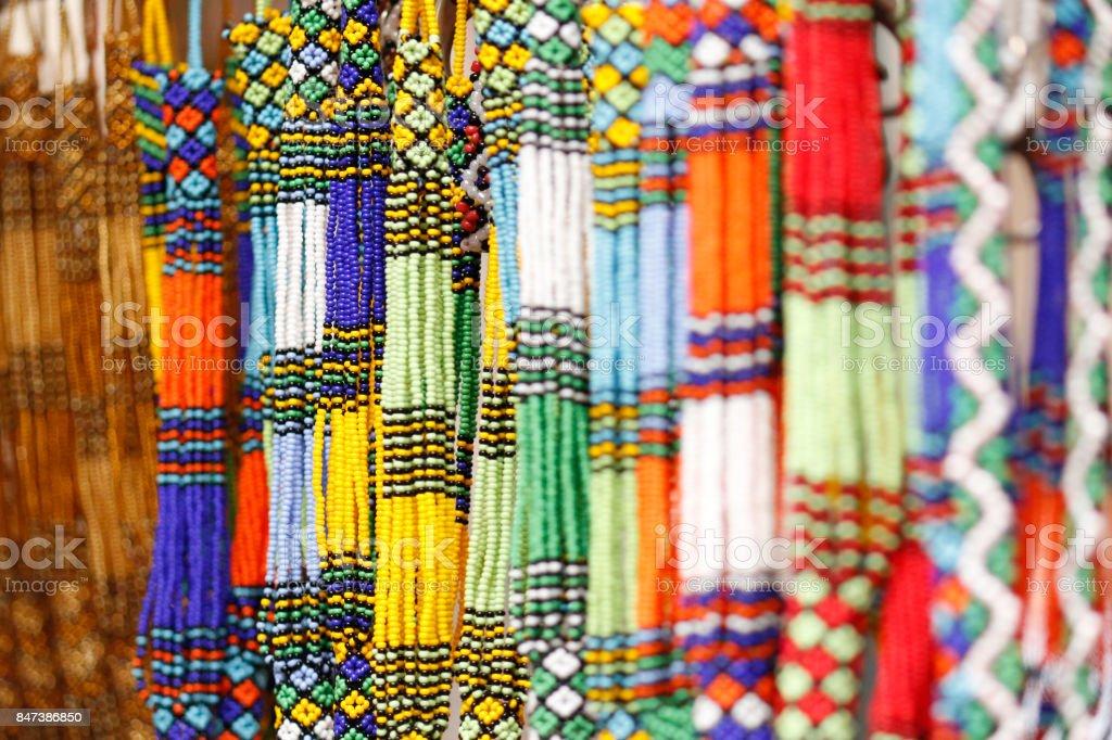 Beads necklace artwork artist colorful design market festival decoration woman stock photo
