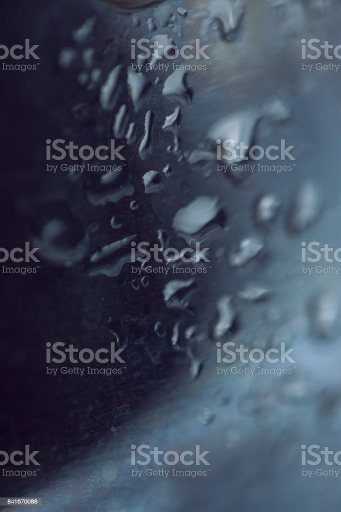 Beads of water on a black background stock photo
