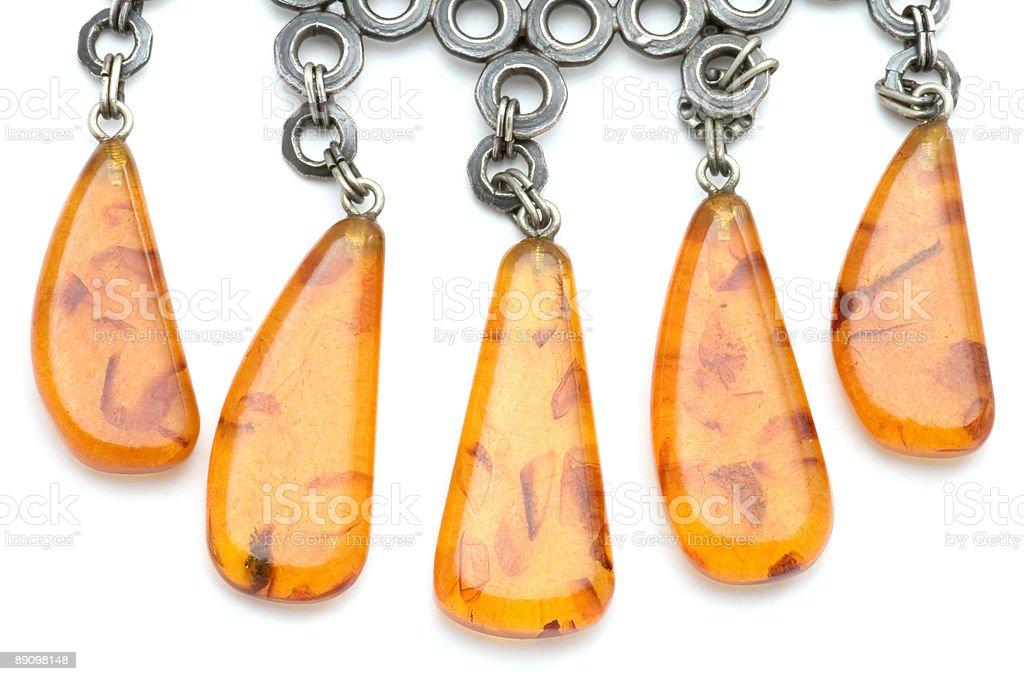 Макро amber с бусинами Стоковые фото Стоковая фотография