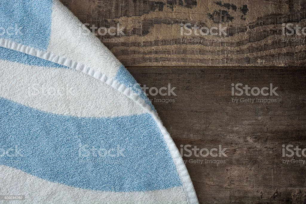 Beah towel on rustic wooden background stock photo