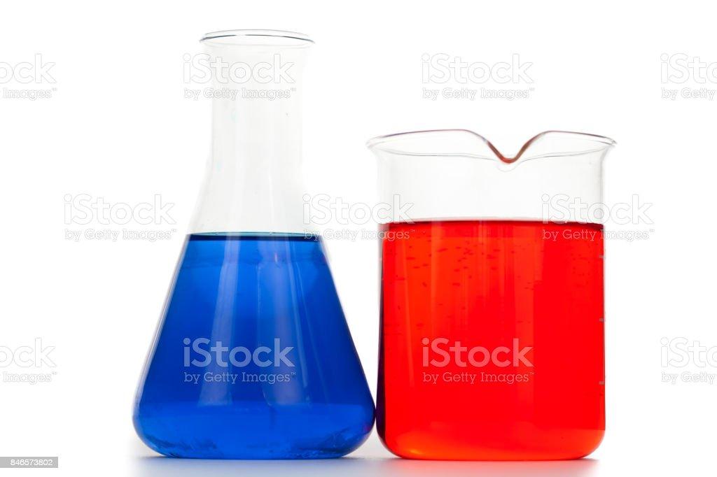 Beaker next to an erlenmeyer stock photo