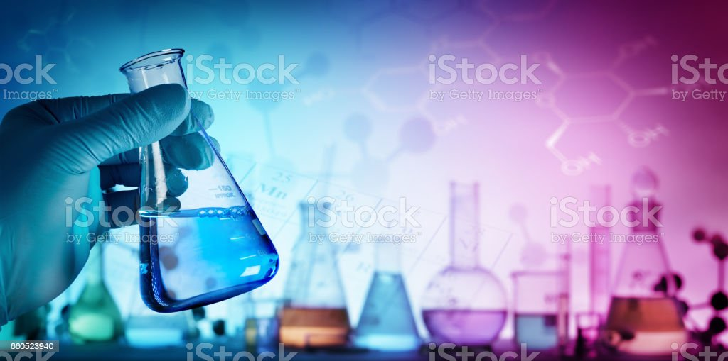 Beaker With Formula In Laboratory stock photo