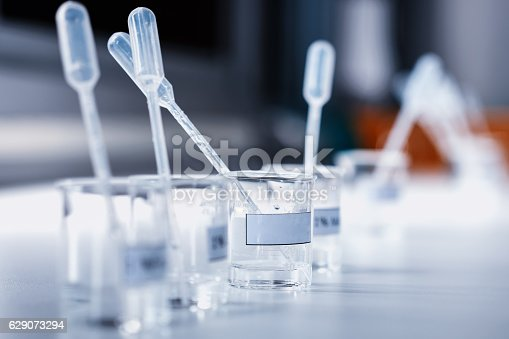 istock beakers with label and chemical reagent. 629073294