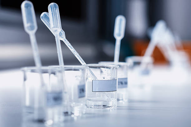 beakers with label and chemical reagent. stock photo