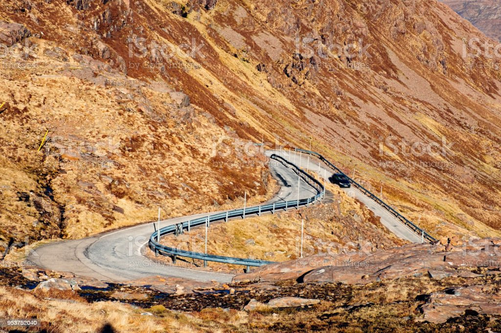 Bealach na Ba, Applecross Peninsula, Scotland Looking down on the hairpin bends of the Bealach na Ba in Wester Ross, Scotland. Blurred Motion Stock Photo