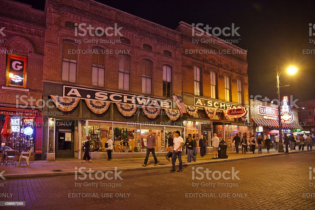 Beale Street, Memphis at Night: People outside A. Schwab. stock photo