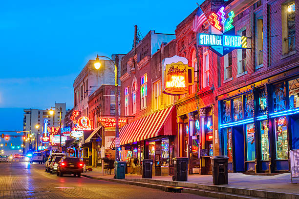 Beale Street Music District in Memphis Tennessee USA Photo of colorful cafe bars at the iconic Beale Street music and entertainment district of downtown Memphis, Tennessee, USA, illuminated at night. tennessee stock pictures, royalty-free photos & images