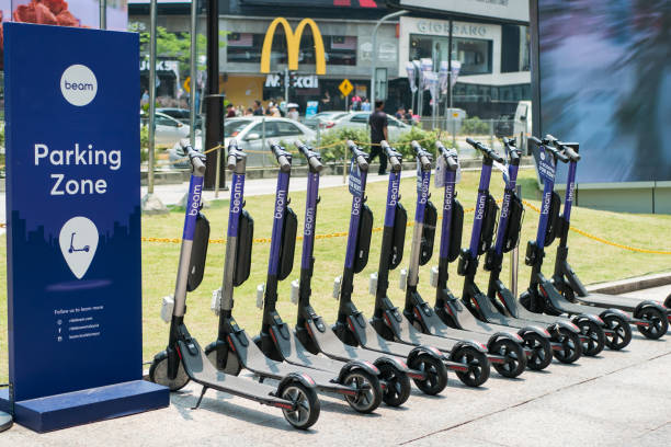 Beam e-scooters in the parking zone for rental at Bukit Bintang area. stock photo