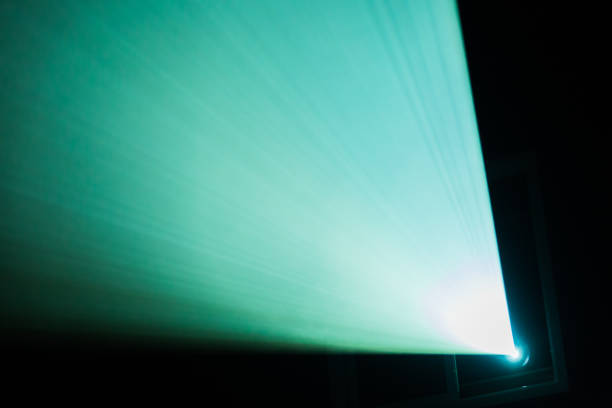 A beam of light from the projector in the cinema. Theatre equipment. Abstract background