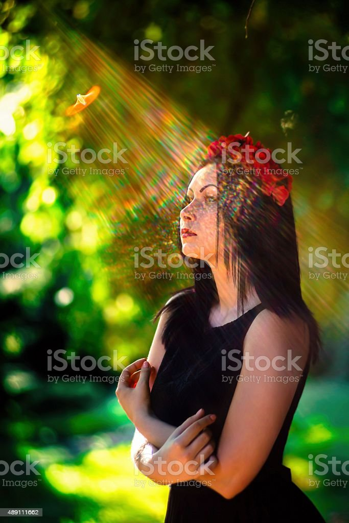Beam of the sun at the face of goth model stock photo