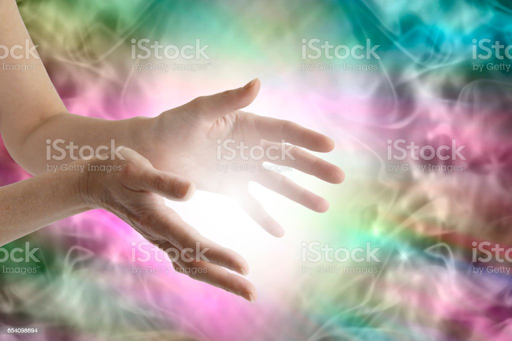Beaming healing energy stock photo