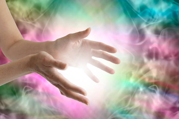 beaming healing energy - aura stock photos and pictures