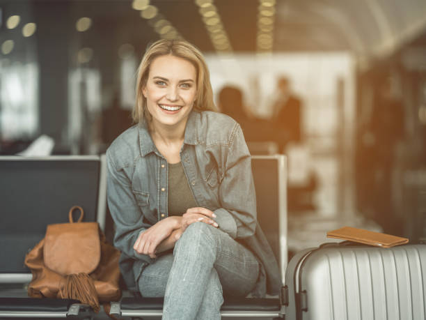 Beaming lady locating in lounge zone stock photo
