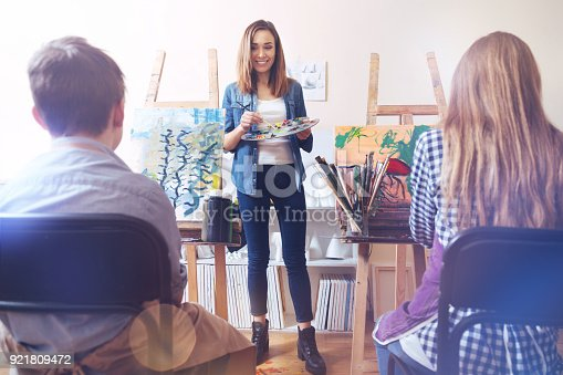 577949148istockphoto Beaming woman staring at talented students 921809472