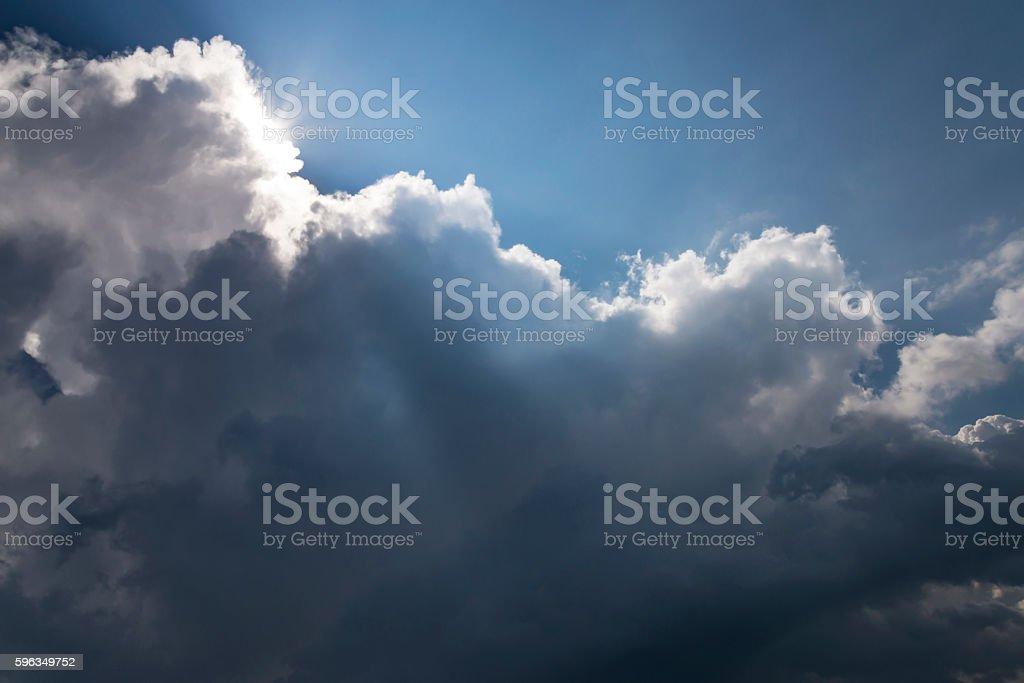 beams of a sun pass through a big storm cloud royalty-free stock photo