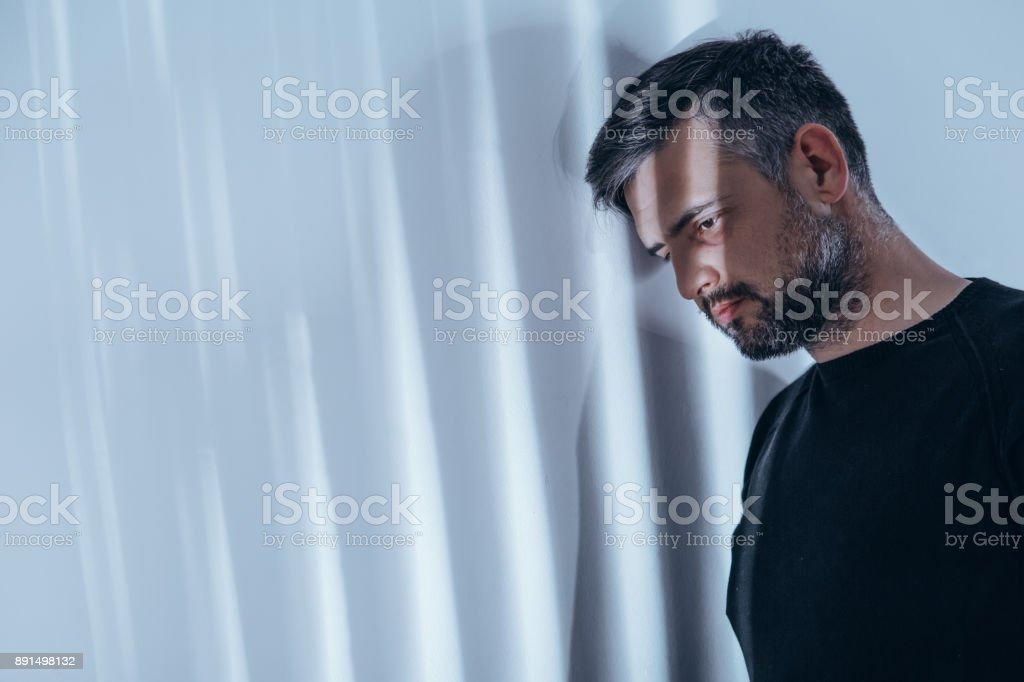 Beams of light shining on man stock photo