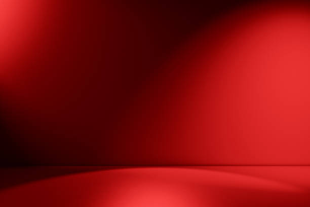 Beams of spotlight on a red background Red empty Studio room for product placement or as a design template with wall angle in a full frame view studio shot stock pictures, royalty-free photos & images