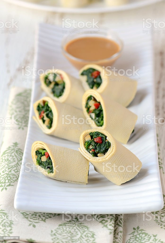 Bean curd sheet roll with Spinach stock photo