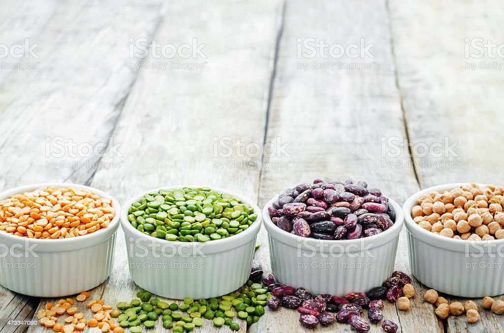 bean. green and yellow peas, colored beans, chickpeas, green and red lentils stock photo