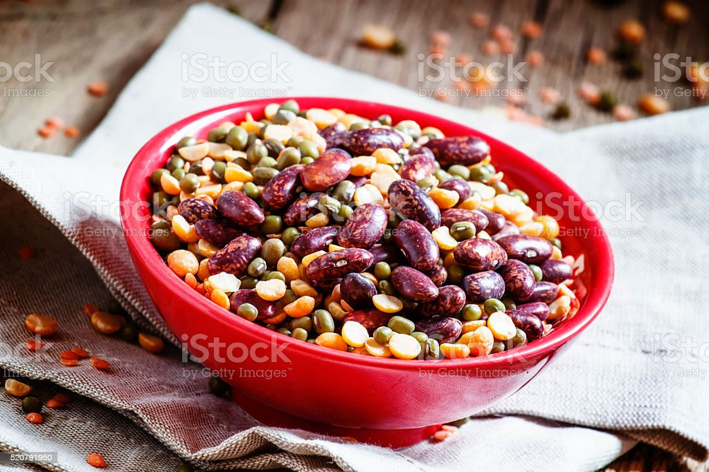 Bean mix: purple beans, green and red lentils, dry peas stock photo