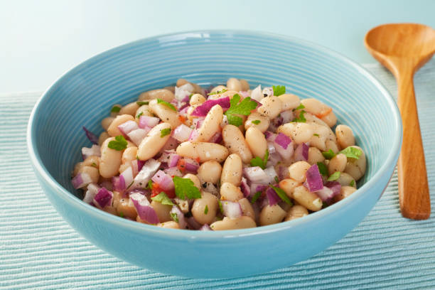 Bean Salad of Cannellini Beans with Red Onion, Parsley and Herbs stock photo
