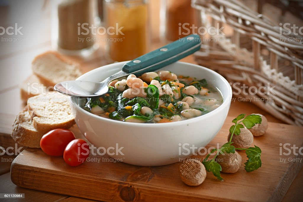 bean soup and spinach stock photo