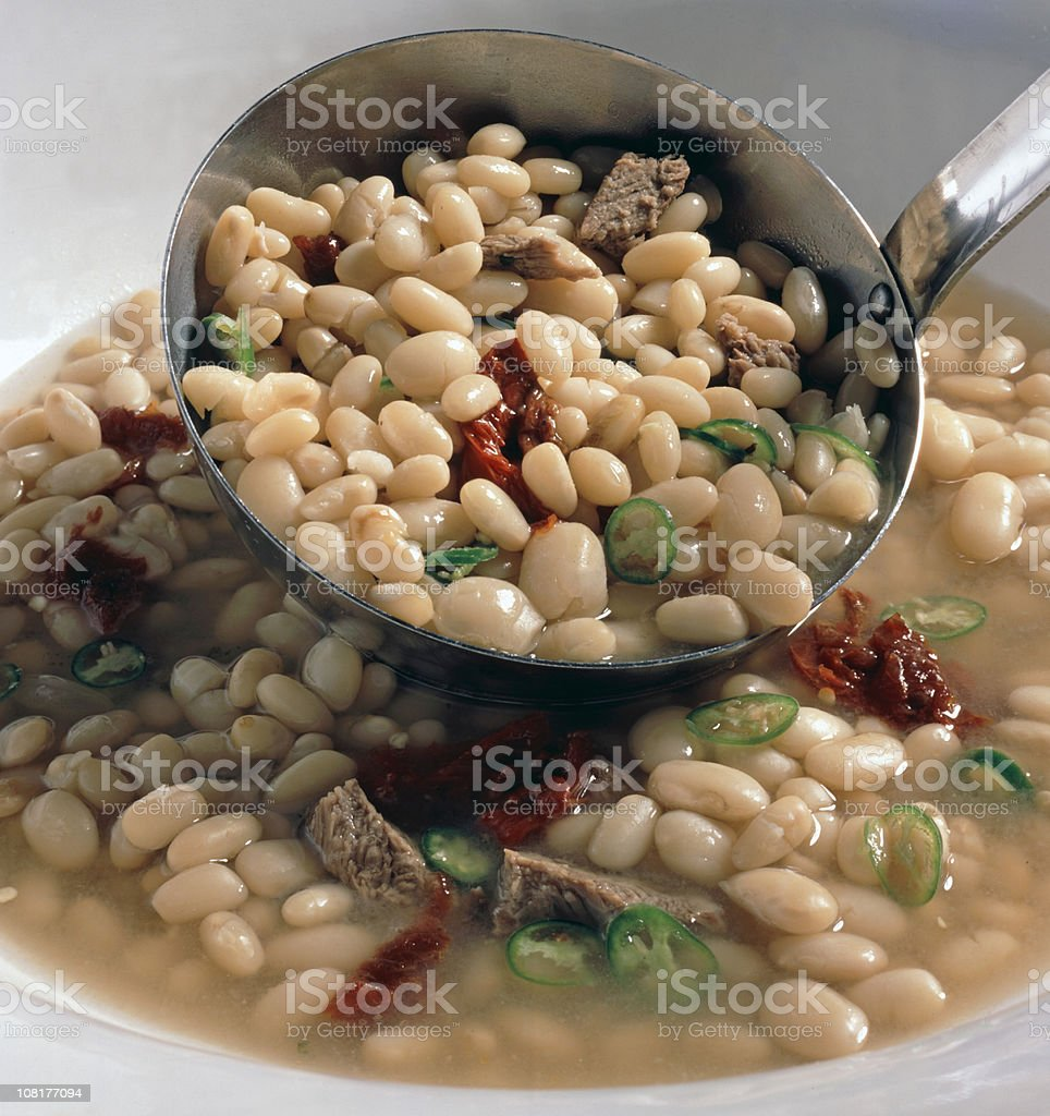 Bean Soup Ladeled into Bowl royalty-free stock photo