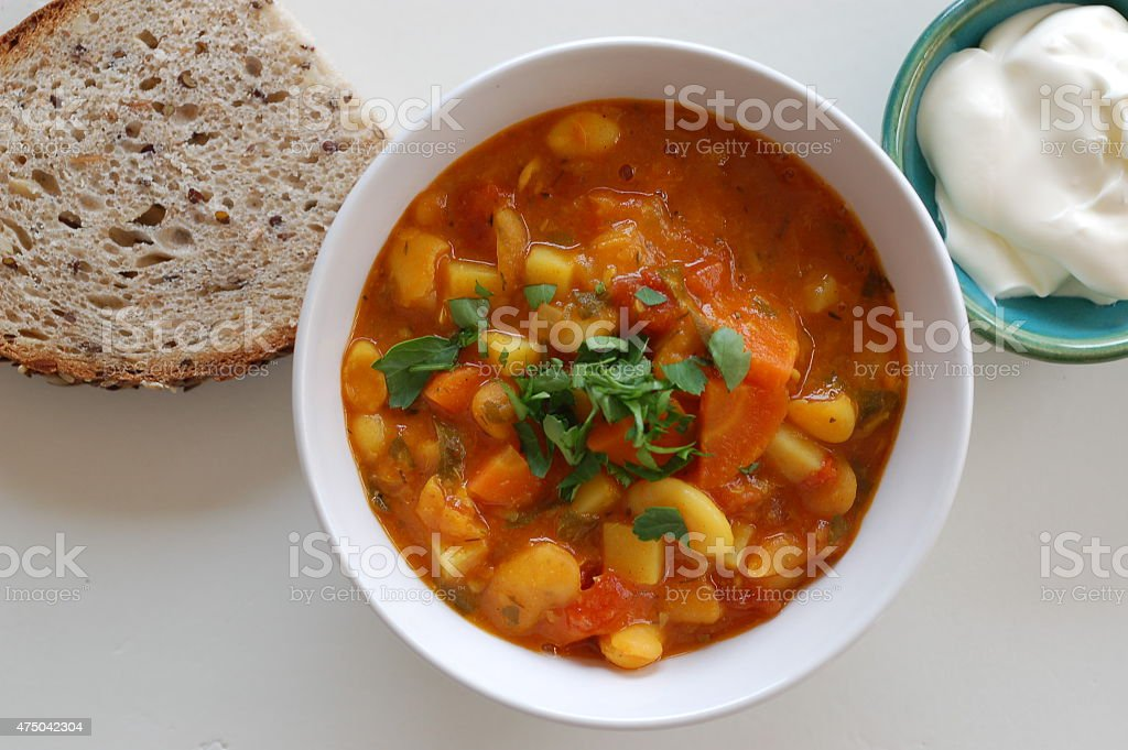 bean soup, sour cream and bread stock photo
