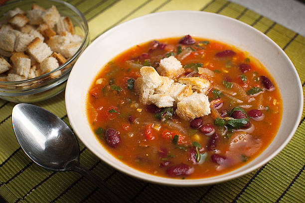 Bean soup with croutons and beans stock photo