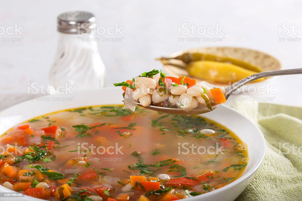 Bean soup with vegetables stock photo